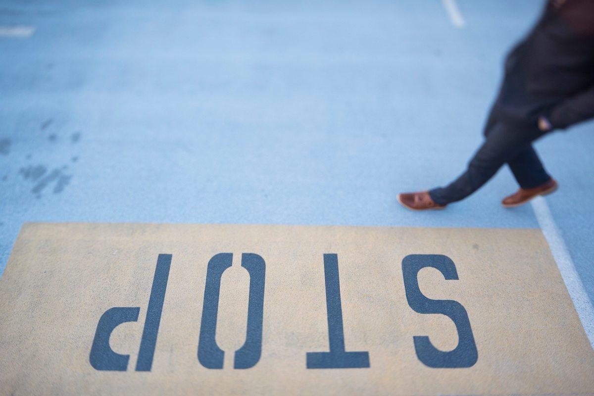 Stop written on the floor