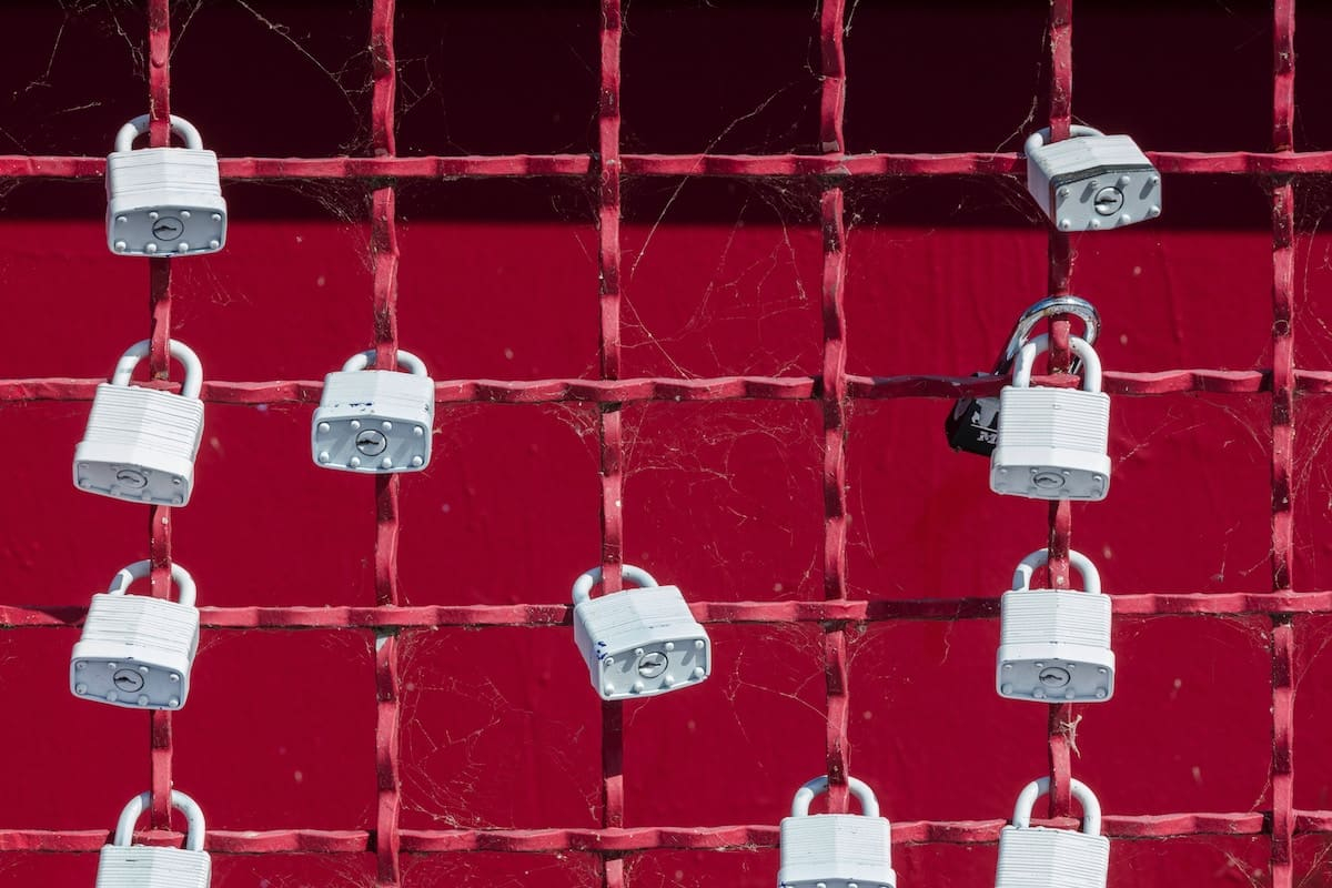 Padlocks on a red fence
