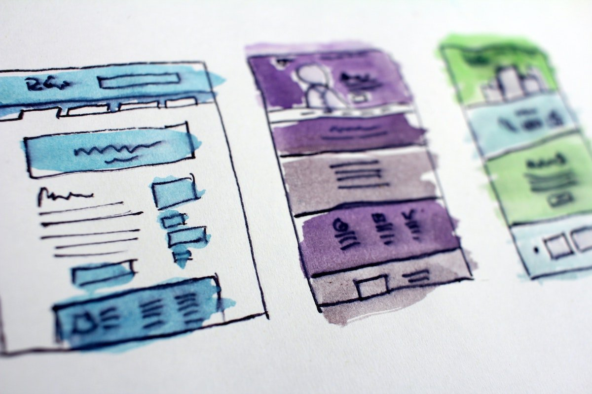 Hand-drawn and hand-colored user interface mockups