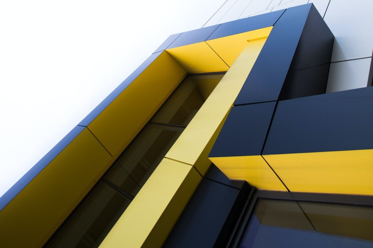 Picture of a blue and yellow building, by William Daigneault