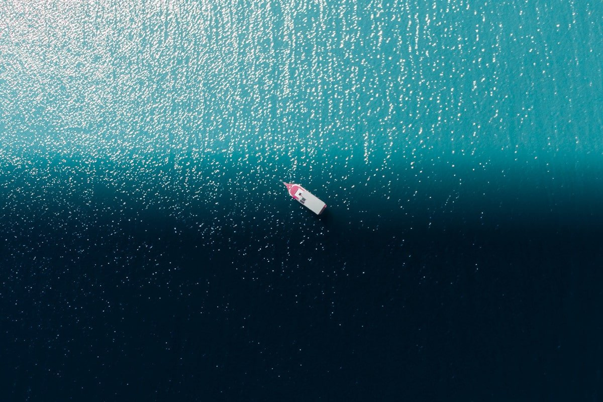 A tiny boat in the middle of the ocean